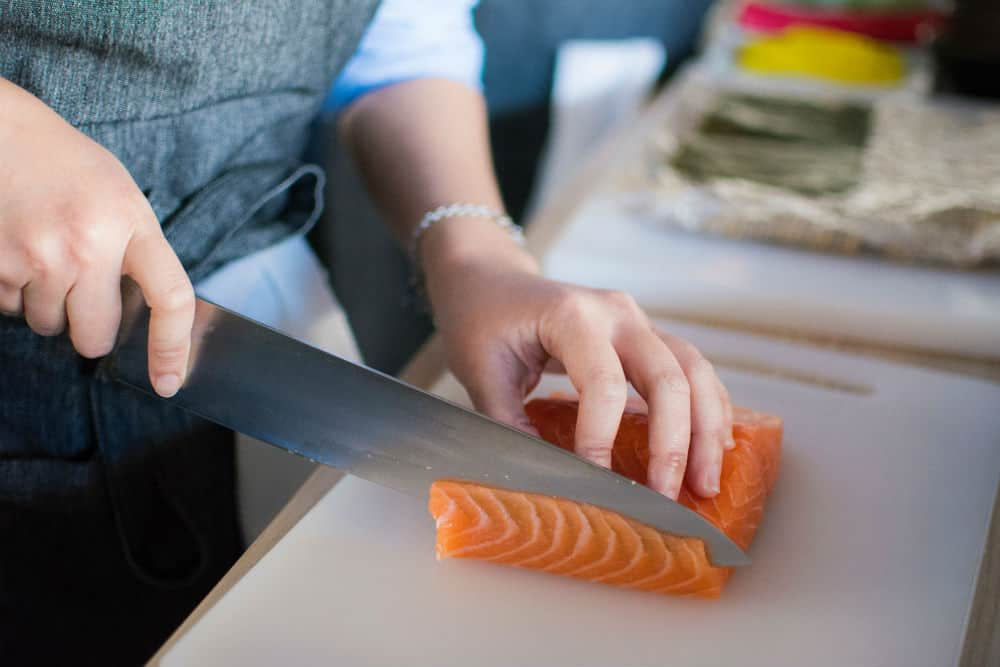 Cut the salmon in the middle for thin japanese style slices