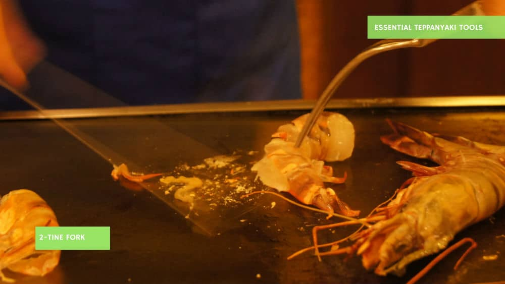 The 2-tine fork is one of the must have Teppanyaki tools to cook