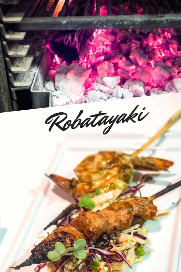 Robatayaki charcoal grill with finished dish underneath