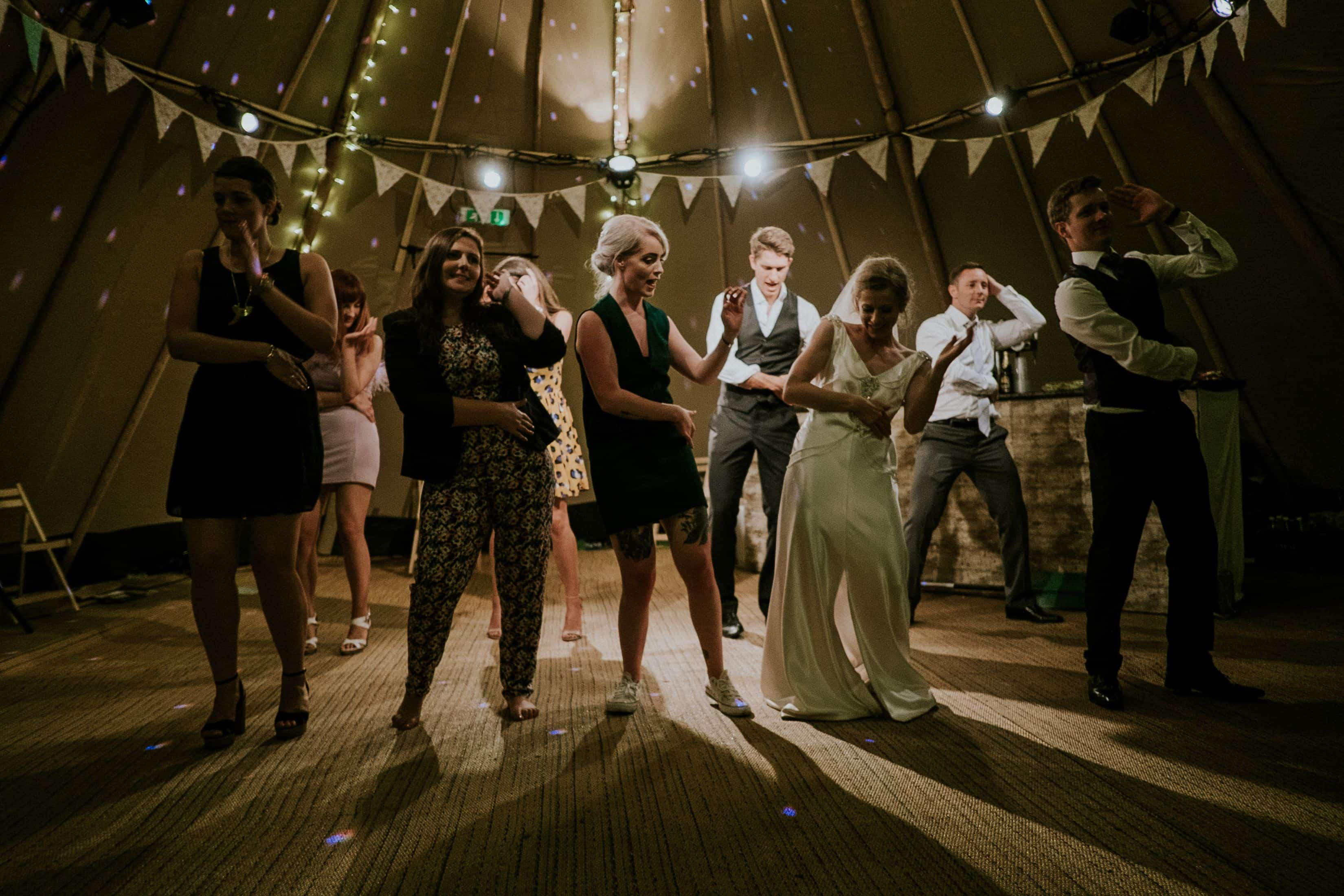 people having fun and dancing in a wedding party