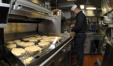 a chef who cook pancakes in a teppanyaki griddle
