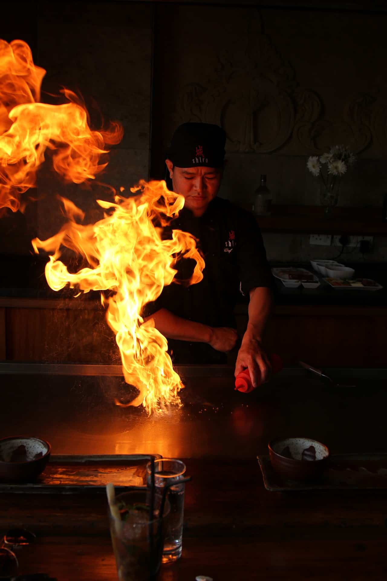 a chef is doing one of teppanyaki tricks, Onion Volcano.