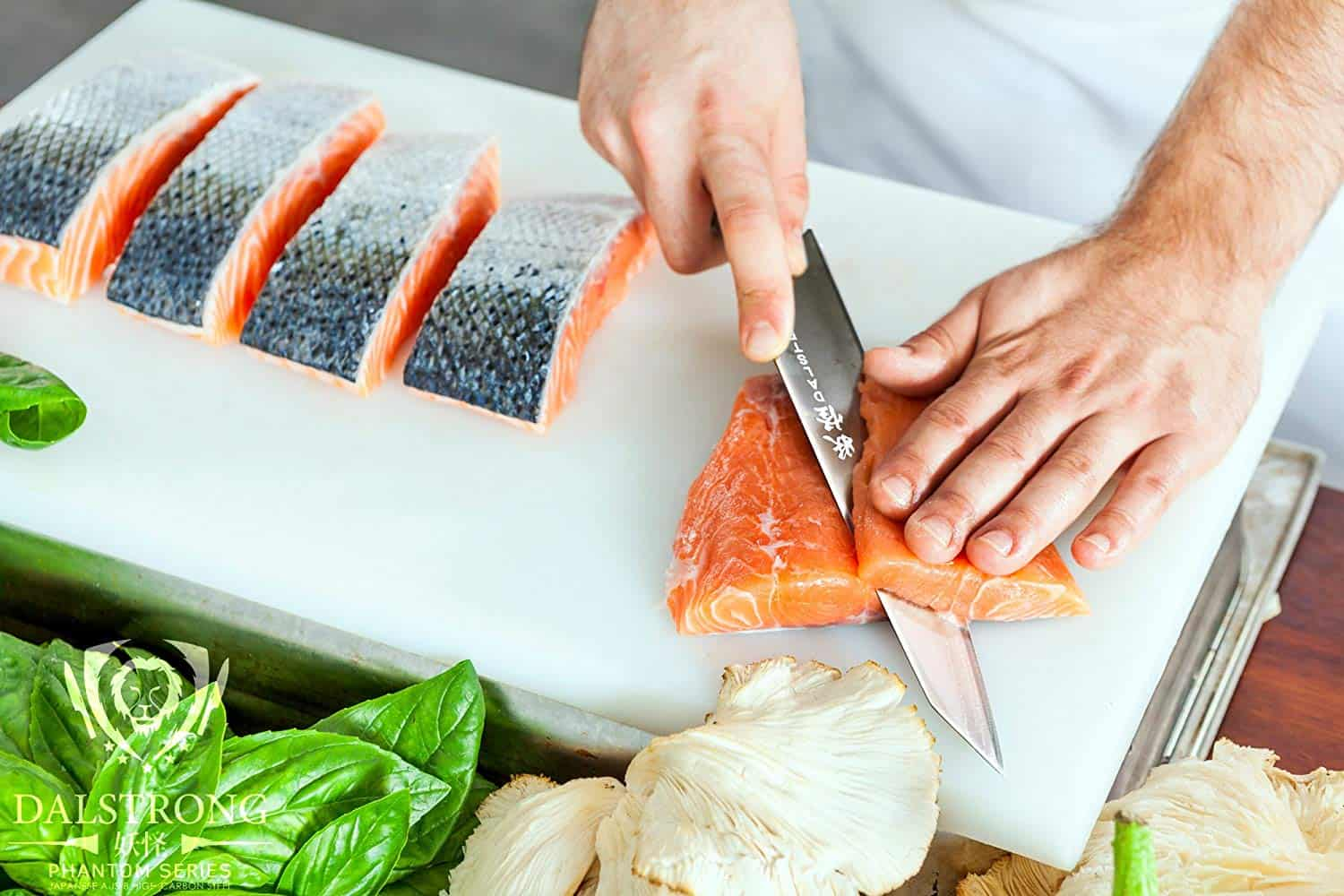 a person cut a salmon with dalstrong knife