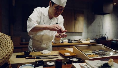 a chef is preparing a japanese dish