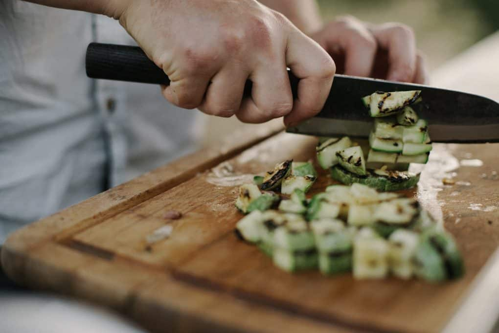 person chop vegetables with a knife