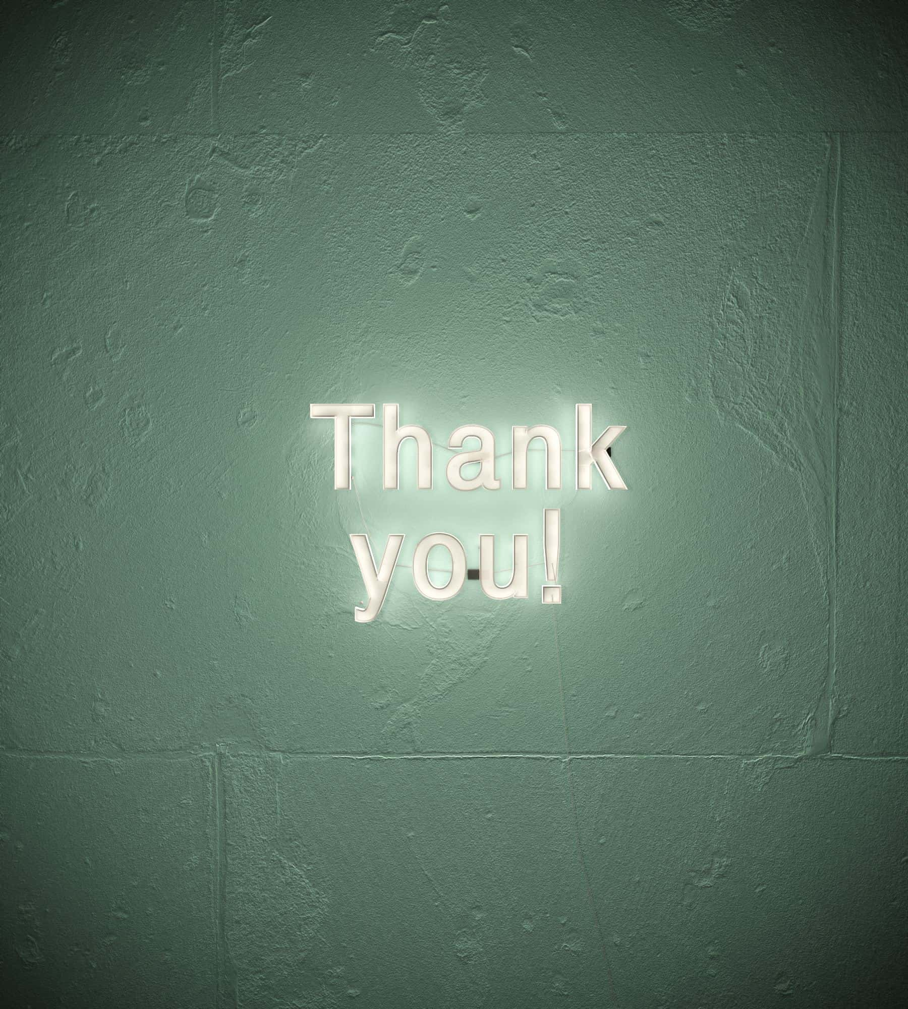 thank you sign on a wall