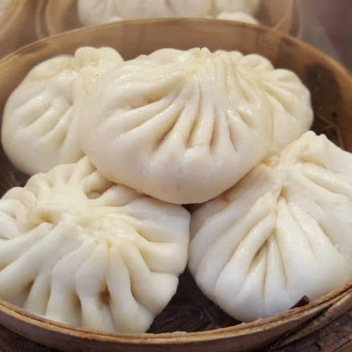 a bowl of japanese steamed bun