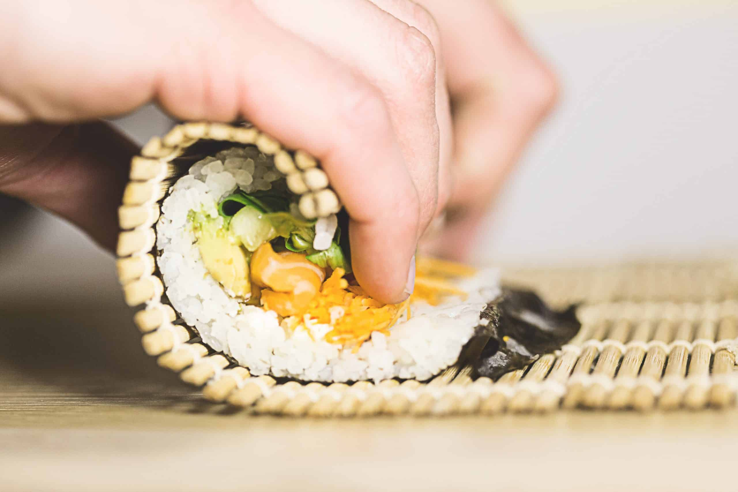 someone is making sushi - Best Sushi Making Kit