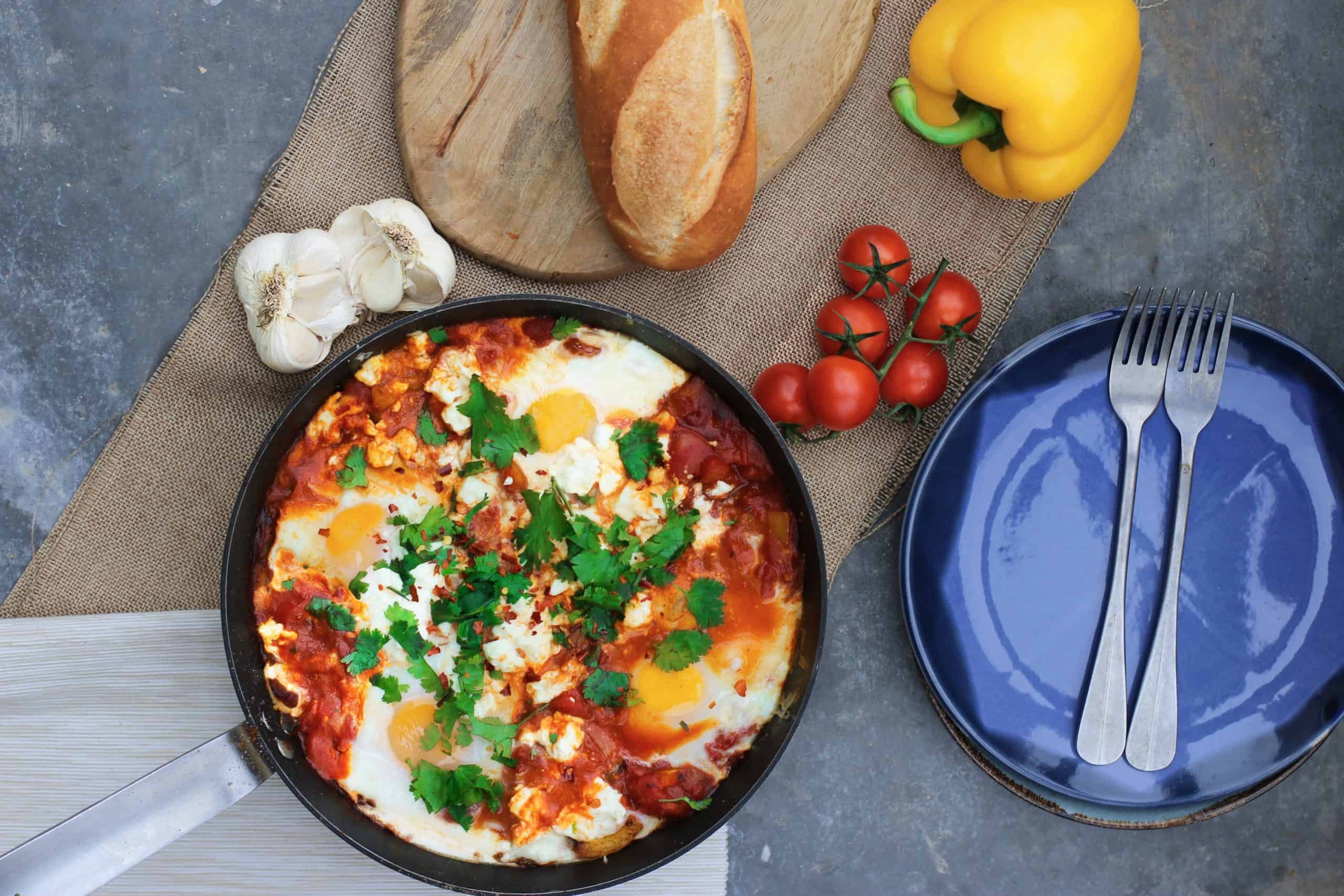 a flat-lay photo of omelette and other dish beside it