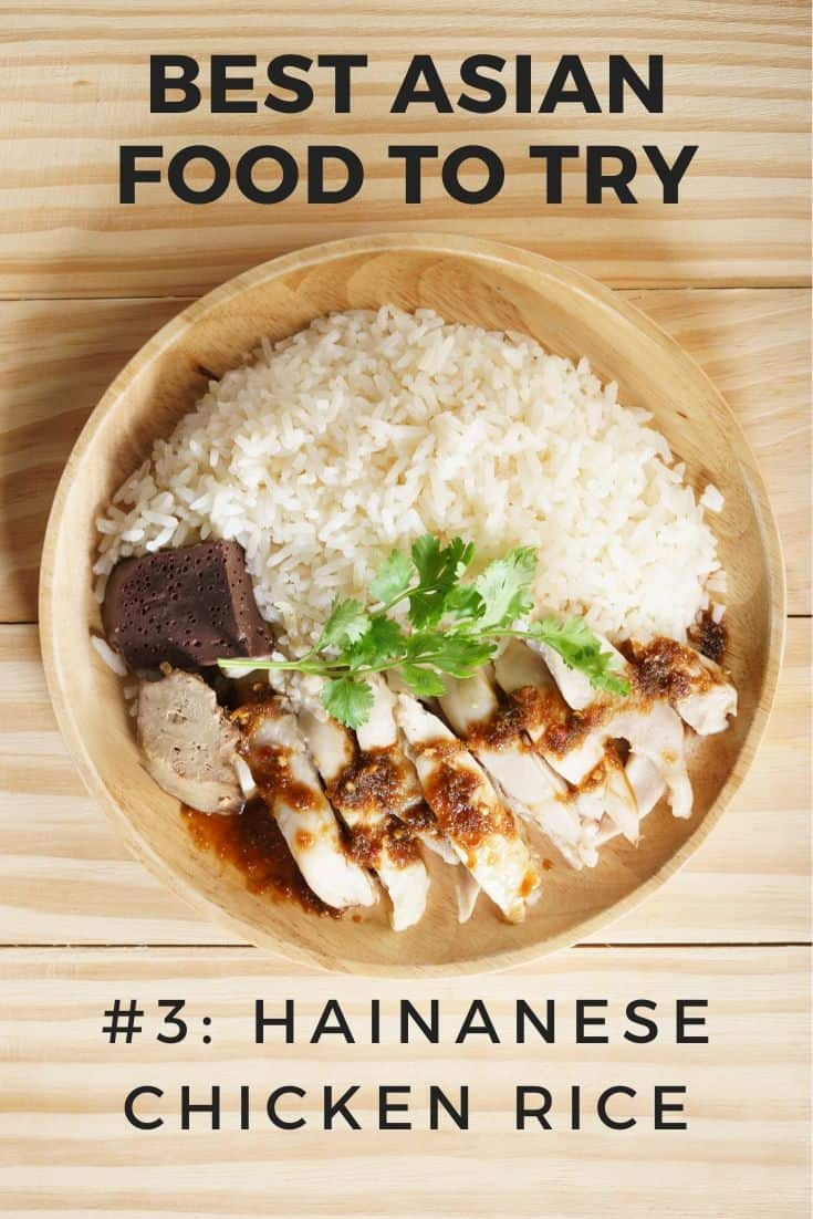 Bowl of Hainanese Chicken Rice on wooden table