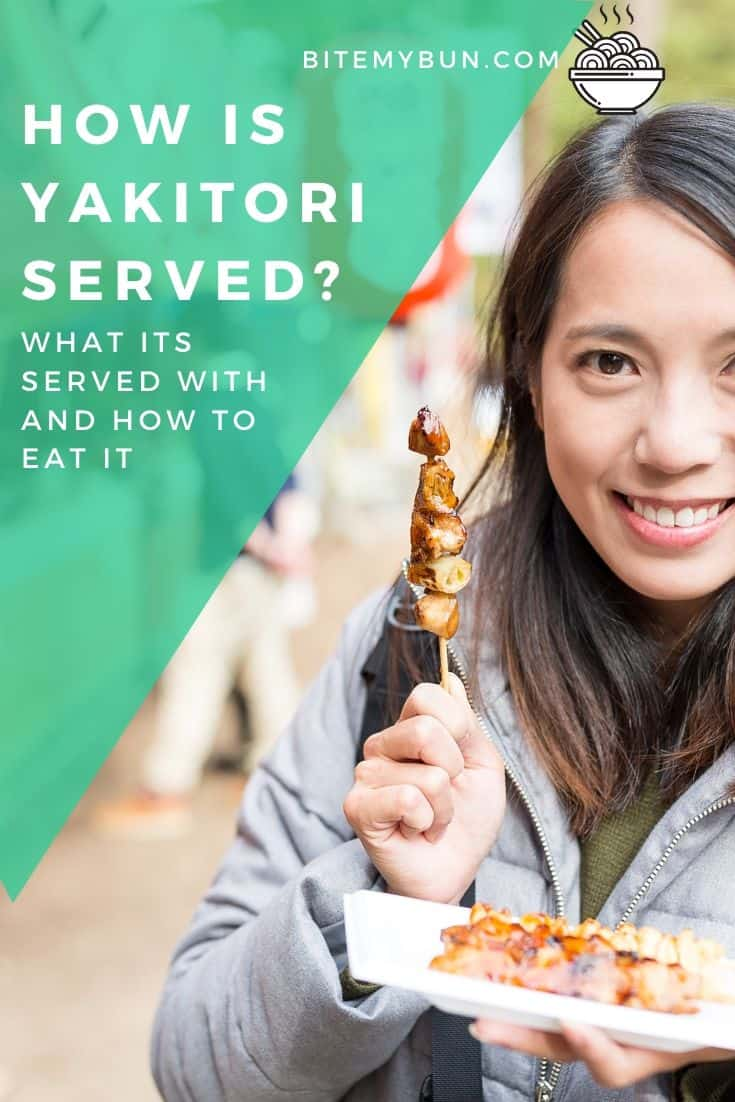 Woman eating yakitori skewers in the street