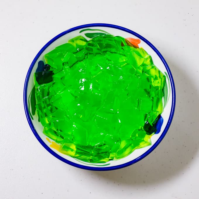 Cubed green gelatin in a bowl