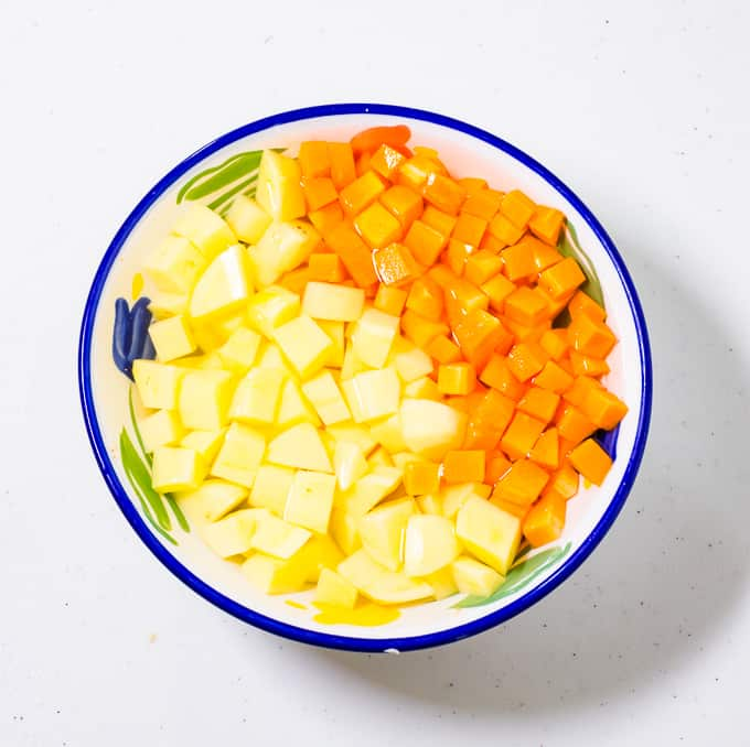 Diced potatoes and carrots in a bowl