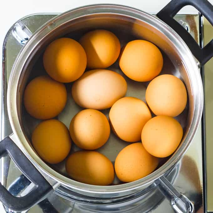 Eggs ready to boil in water in a pan