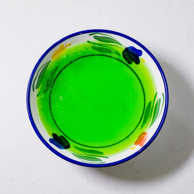 Green gelatin in a bowl