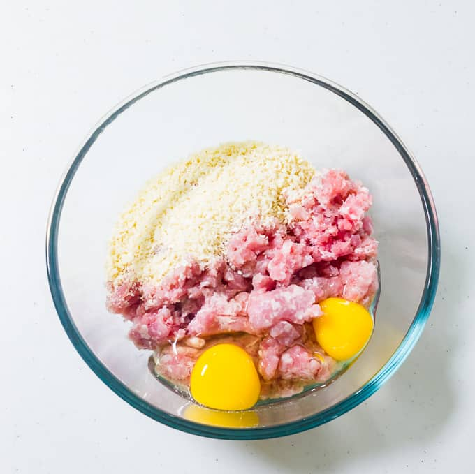 Mixing bowl with pork meat and raw eggs