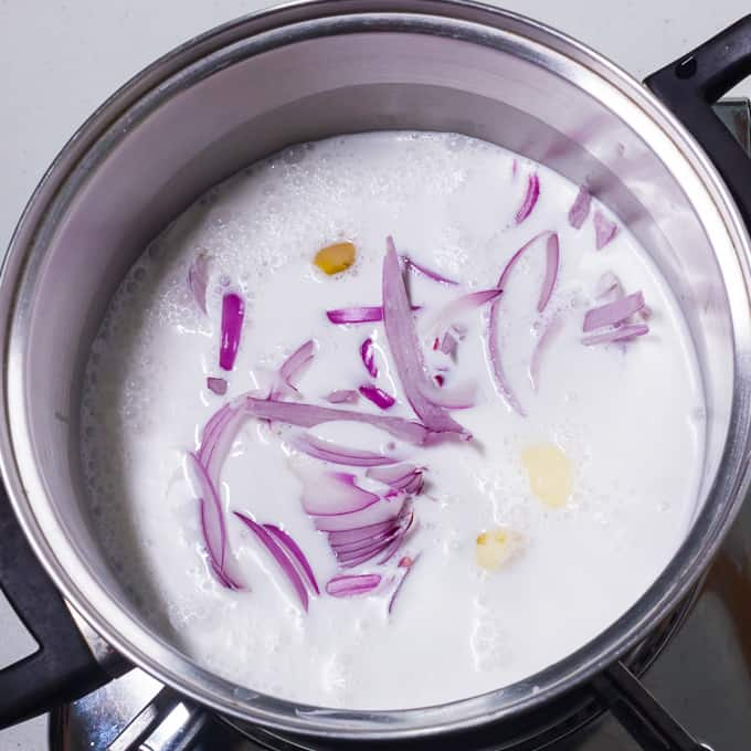 Onions ginger and garlic in coconut milk