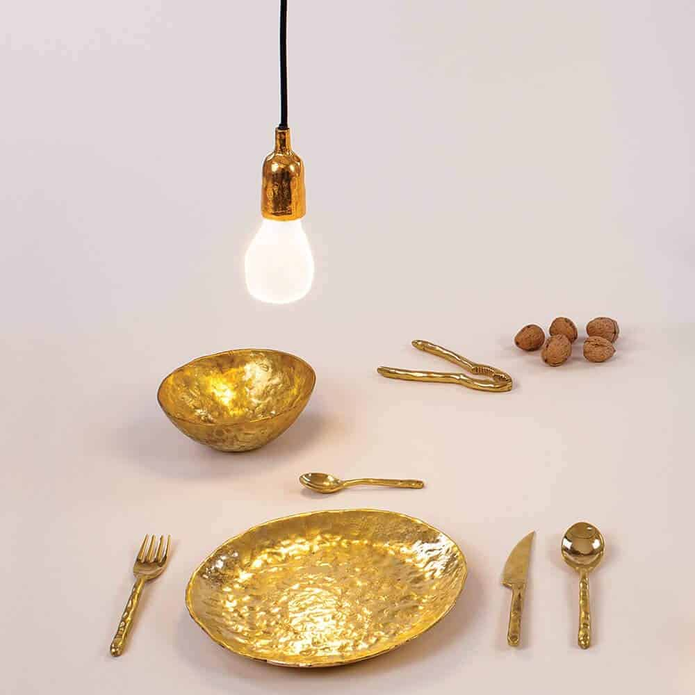 Best brass dinner plates: Seletti Fingers