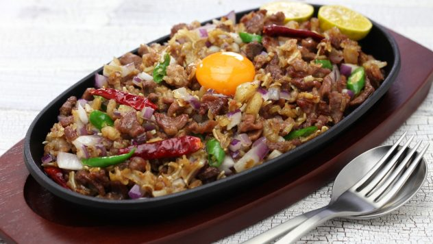 Raw egg on top of sizzling pork sisig