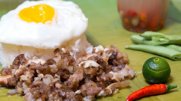 Sisig served with rice and egg