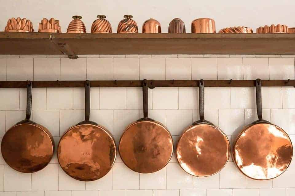 Hanging copper pans as decoration