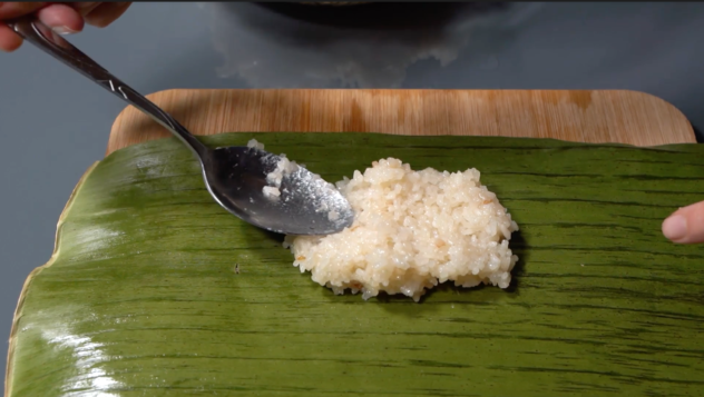 Suman Malagkit Recipe placing the rice in the banana leaf