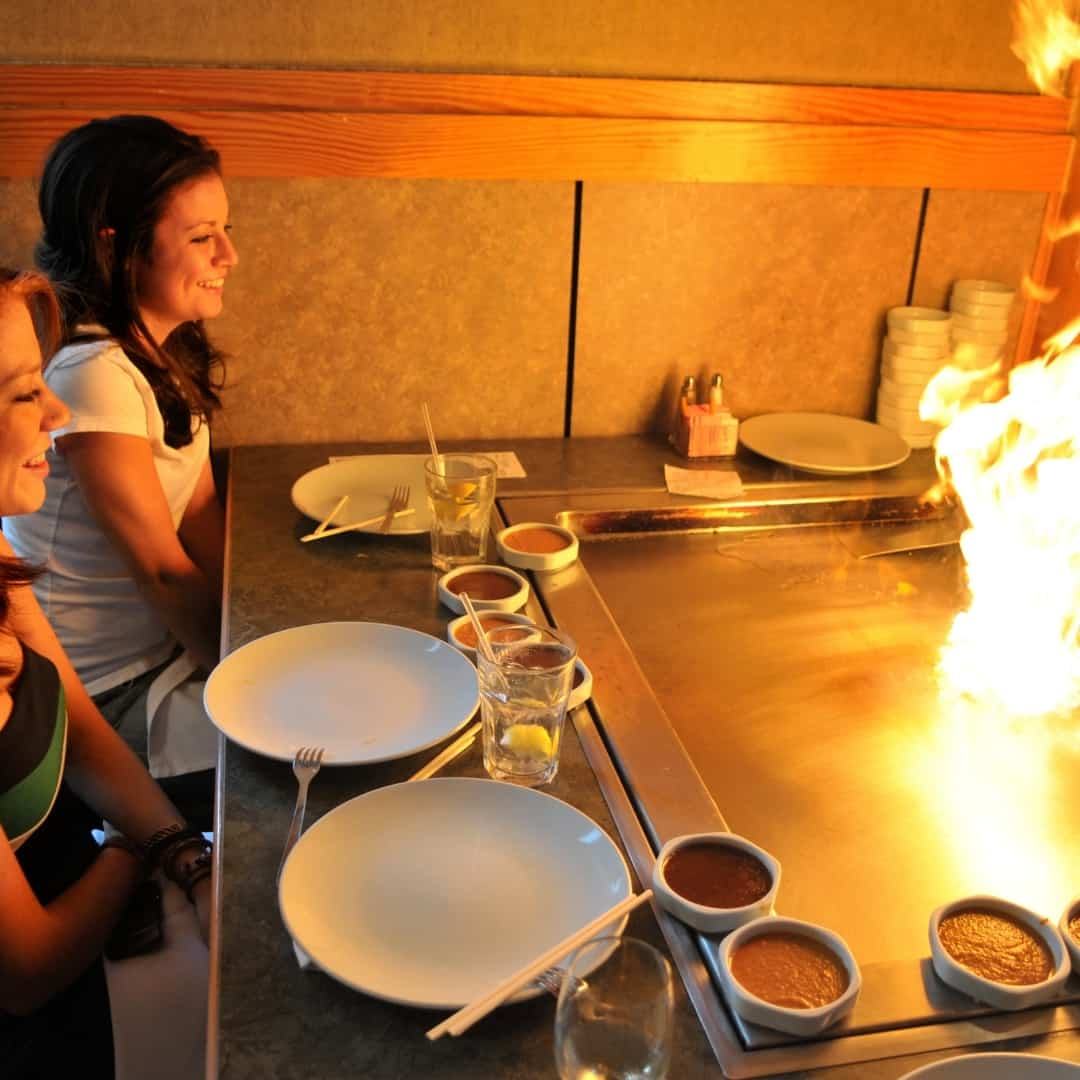 Cooking in front of you on a teppanyaki grill