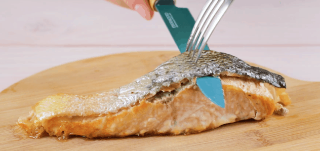 Remove skin and bones from baked salmon
