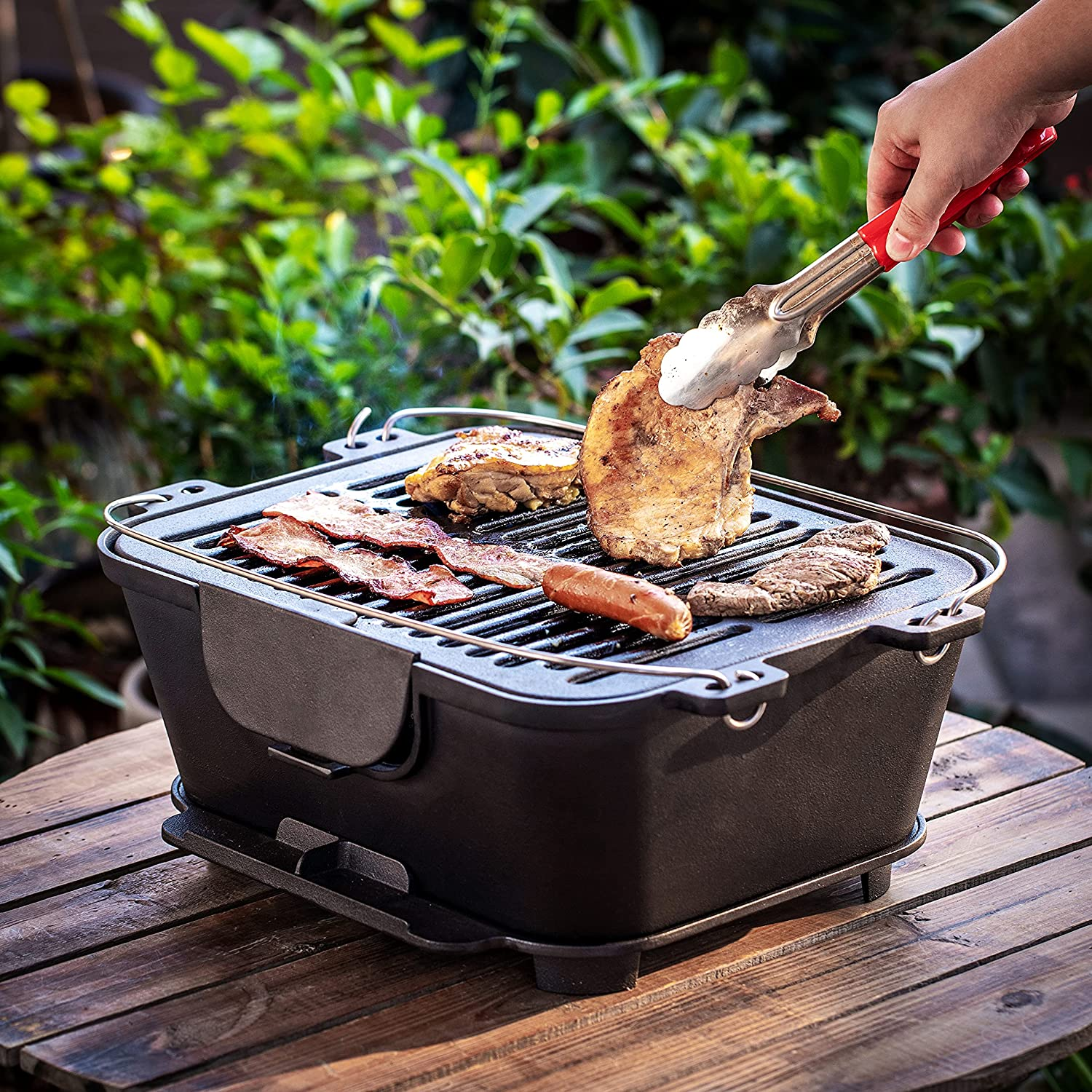 Best for camping and outdoor cooking- Bruntmor Pre-Seasoned Hibachi-Style Grill outside grilling