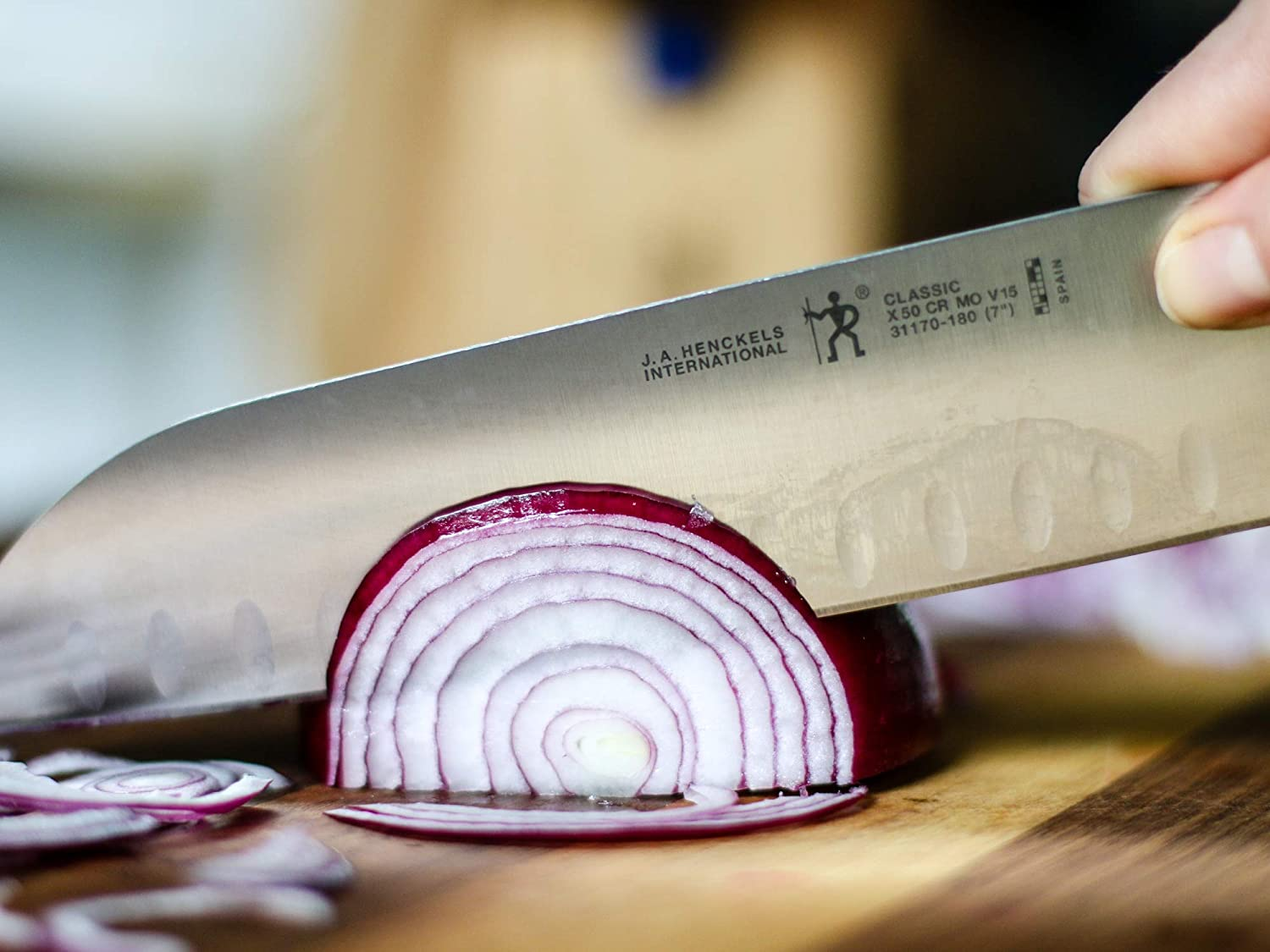Best mid-priced santoku knife- J.A. HENCKELS Classic Hollow Edge in use