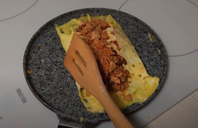 Fold both sides of the egg towards the middle with a spatula