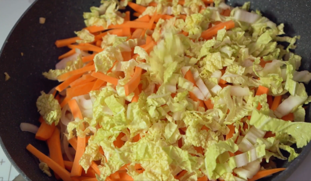 Add the onion, carrot, cabbage